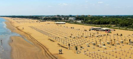 Spacious spots on Bibione beach, surrounded by greenery